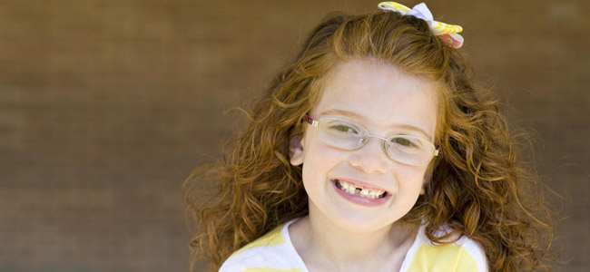 Childrens Dentistry Danbury - little girl with glasses smiling