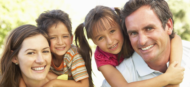 Happy Family of four who use Soams Dental Care for their Restorative Dentistry needs in Danbury, CT