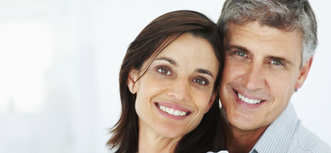 Dental Implants Danbury CT - Couple smiling and hugging