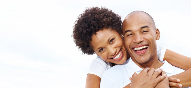 Invisalign Danbury CT - Couple holding each other big smiles